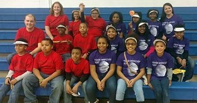 Team M.E.R.C.U.R.Y. and Robo Rams at the regional First Lego League tournament.